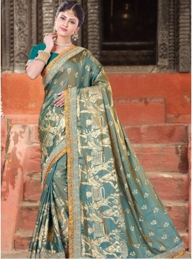 Mahotsav Cord And Sequins Embroidery, Foil Print Blouse Fabric Raw Silk Turquoise Green Color Saree
